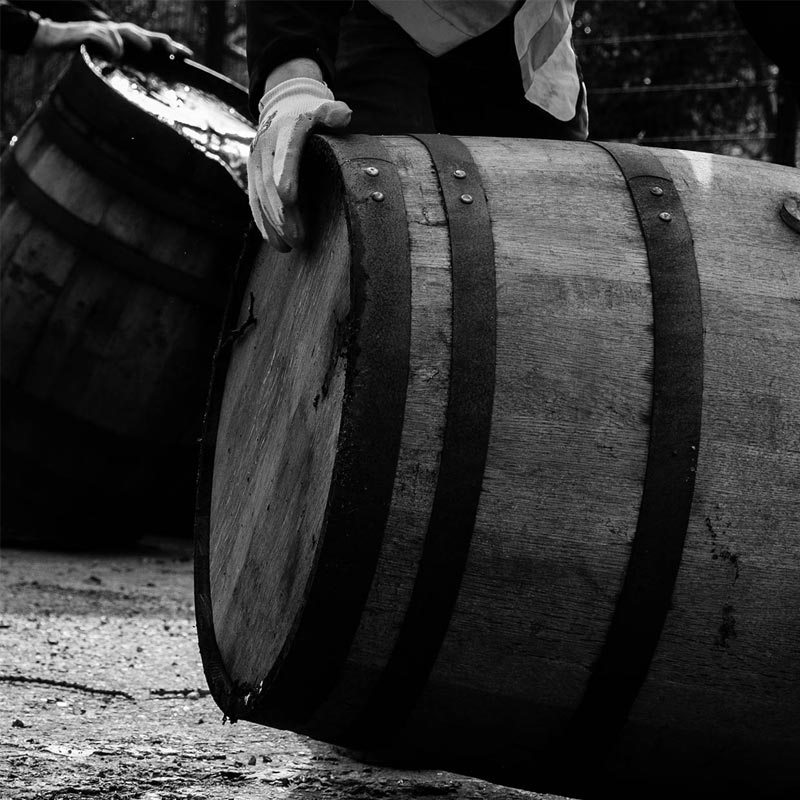 Rum barrels being rolled